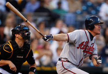 PITTSBURGH - MAY 24:  Chipper Jones #10 of the Atlanta Braves hits a double against the Pittsburgh Pirates during the game on May 24, 2011 at PNC Park in Pittsburgh, Pennsylvania.  (Photo by Jared Wickerham/Getty Images)