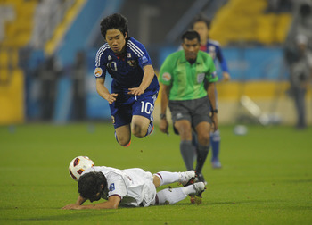 DOHA, QATAR - JANUARY 21: Shinji Kagawa of Japan in action during the AFC Asian Cup quarter final match between Japan and Qatar at Al-Gharafa Stadium on January 21, 2011 in Doha, Qatar.  (Photo by Koki Nagahama/Getty Images)