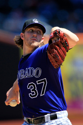 NEW YORK, NY - APRIL 14:  Greg Reynolds #37 of the Colorado Rockies pitches against the New York Mets at Citi Field on April 14, 2011 in the Flushing neighborhood of the Queens borough of New York City.  (Photo by Chris Trotman/Getty Images)