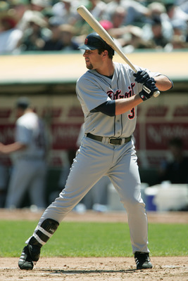 OAKLAND, CA - AUGUST 12:  Infielder Eric Munson #31 of the Detroit Tigers waits for an Oakland Athletics pitch during the game at the Network Associates Coliseum on August, 12, 2004 in Oakland, California. The Tigers won 5-3.  (Photo by Jed Jacobsohn/Gett