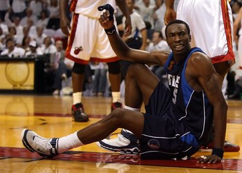 MIAMI - JUNE 13:  Josh Howard #5 of the Dallas Mavericks is on the ground late in the fourth quarter of game three of the 2006 NBA Finals against the Miami Heat on June 13, 2006 at American Airlines Arena in Miami, Florida.  The Heat defeated the Mavs 98-