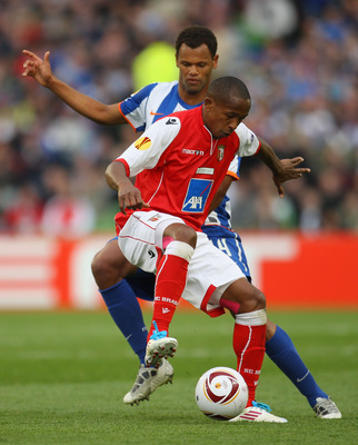 DUBLIN, IRELAND - MAY 18:  Rolando of FC Porto challenges Paulo Cesar of SC Braga during the UEFA Europa League Final between FC Porto and SC Braga at Dublin Arena on May 18, 2011 in Dublin, Ireland.  (Photo by Alex Livesey/Getty Images)
