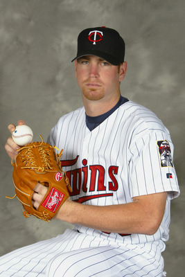FT. MYERS, FL - MARCH 1:  Pitcher Adam Johnson #38 of the Minnesota Twins poses for portrait during Twins Photo Day at the Twins Spring Training Complex on March 1, 2004 in Fort Myers, Florida.  (Photo by Ezra Shaw/Getty Images)