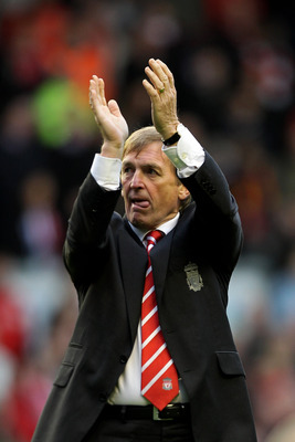 LIVERPOOL, ENGLAND - MAY 15:  Liverpool manager Kenny Dalglish applauds the home fans following the final whistle during the Barclays Premier League match between Liverpool and Tottenham Hotspur at Anfield on May 15, 2011 in Liverpool, England.  (Photo by