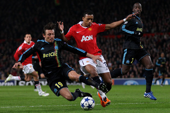 MANCHESTER, ENGLAND - MARCH 15:  Gabriel Heinze (L) of Marseille battles for the ball with Nani of Manchester United during the UEFA Champions League round of 16 second leg match between Manchester United and Marseille at Old Trafford on March 15, 2011 in