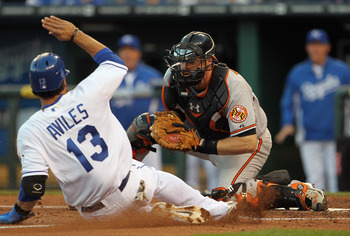 KANSAS CITY, MO - MAY 03:  Catcher Matt Wieters #32 of the Baltimore Orioles tags out Mike Aviles #13 of the Kansas City Royals at home plate during the game on May 3, 2011 at Kauffman Stadium in Kansas City, Missouri.  (Photo by Jamie Squire/Getty Images