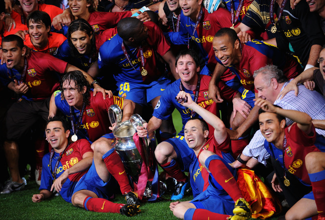 ROME - MAY 27:  Barcelona players pose in front of the trophy after they celebrate winning the UEFA Champions League Final match between Barcelona and Manchester United at the Stadio Olimpico on May 27, 2009 in Rome, Italy. Barcelona won 2-0.  (Photo by S