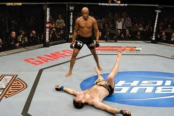 Silva stands over a beaten Forrest Griffin at UFC 101.