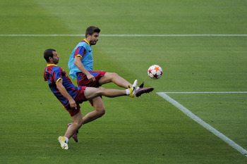 BARCELONA, SPAIN - MAY 23:  Javier Mascherano of FC Barcelona (L) and his teammate Gerard Pique duels for the ball during the FC Barcelona training session held ahead of next Saturday's UEFA Champions League Final at the Camp Nou Stadium on May 23, 2011 i