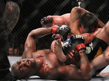 A tired and battered Anderson Silva chokes out Chael Sonnen in round 5 to retain his middleweight belt.