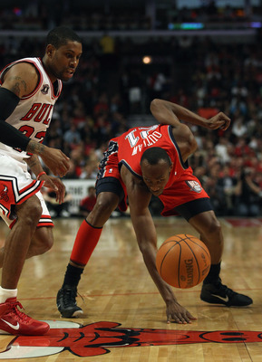 CHICAGO, IL - APRIL 13: Travis Outlaw #21 of the New Jersey Nets looses control of the ball as C.J. Watson #32 of the Chicago Bulls defends at the United Center on April 13, 2011 in Chicago, Illinois. NOTE TO USER: User expressly acknowledges and agrees t