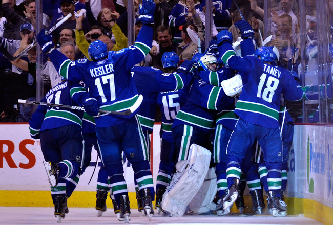 VANCOUVER, CANADA - MAY 24:  Mason Raymond #21, Ryan Kesler #17, Tanner Glass #15, goaltender Roberto Luongo #1 and Chris Tanev #18 of the Vancouver Canucks and their teammates celebrate after they defeated the San Jose Sharks 3-2 in double-overtime in Ga