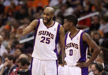 PHOENIX, AZ - MARCH 13:  Vince Carter #25 and Aaron Brooks #0 of the Phoenix Suns during the NBA game against the Orlando Magic at US Airways Center on March 13, 2011 in Phoenix, Arizona.  NOTE TO USER: User expressly acknowledges and agrees that, by down