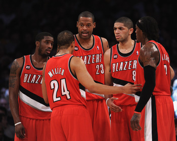 LOS ANGELES, CA - MARCH 20:   Wesley Mathews #2, Marcus Camby #23, Nicolas Batum #88, Gerald Wallace #3 and Andre MIller #24 of the Portland Trail Blazers meet on the court against the Los Angeles Lakers at the Staples Center on March 20, 2011 in Los Ange