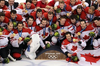 VANCOUVER, BC - FEBRUARY 28:  Team Canada poses for a team photo with their gold medals after winning the ice hockey men's gold medal game between USA and Canada on day 17 of the Vancouver 2010 Winter Olympics at Canada Hockey Place on February 28, 2010 i