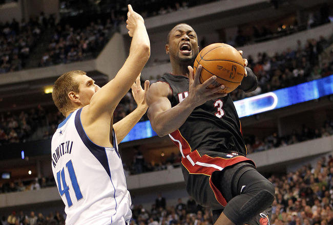 DALLAS - NOVEMBER 27: Dwyane Wade #3 of the Miami Heat drives by Dirk Nowitzki #41 of the Dallas Mavericks on November 27, 2010 at the American Airlines Center in Dallas, Texas. NOTE TO USER: User expressly acknowledges and agrees that, by downloading and