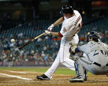 HOUSTON - SEPTEMBER 15:  Brian Bogusevic #19 of the Houston Astros singles in the fifth inning knocking in two runs against the Milwaukee Brewers on September 15, 2010 in Houston, Texas.  (Photo by Bob Levey/Getty Images)