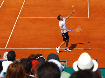 MONTE CARLO, MONACO - APRIL 14:  Giles Simon of France serves during his defeat to Andreas Beck of Germany during day two of the ATP Masters Series at the Monte Carlo Country Club on April 14, 2009 in Monte Carlo,Monaco.  (Photo by Michael Steele/Getty Im