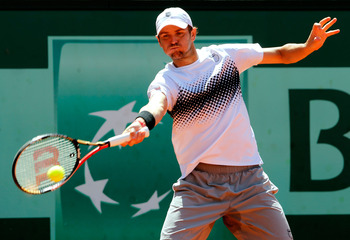 PARIS, FRANCE - MAY 23:  Mardy Fish of USA plays a forehand during the men's singles first round match between Mardy Fish of USA and Ricardo Mello of Brazil on day two of the French Open at Roland Garros on May 23, 2011 in Paris, France.  (Photo by Matthe