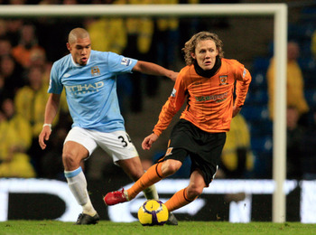 MANCHESTER, ENGLAND - NOVEMBER 28: Nigel de Jong of Manchester City follows Jimmy Bullard of Hull City during the Barclays Premier League match between Manchester City and Hull City at the City of Manchester Stadium on November 28, 2009 in Manchester, Eng