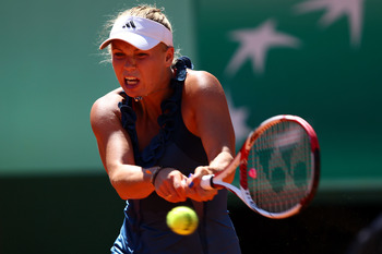 PARIS, FRANCE - MAY 25:  Caroline Wozniacki of Denmark hits a backhand during the women's singles round two match between Caroline Wozniacki of Denmark and Aleksandra Wozniak of Canada on day four of the French Open at Roland Garros on May 25, 2011 in Par