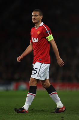 MANCHESTER, ENGLAND - OCTOBER 20:  Captain Nemanja Vidic of Manchester United looks on during the UEFA Champions League Group C  match between Manchester United and Bursaspor Kulubu at Old Trafford on October 20, 2010 in Manchester, England.  (Photo by Al