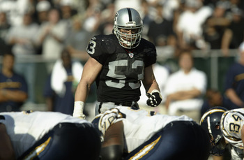 OAKLAND, CA - OCTOBER 20:  Bill Romanowski #53 of the Oakland Raiders gets ready to move at the snap during the game against the San Diego Chargers on October 20,  2002 at Network Associates Coliseum in Oakland, California. The Chargers won 27-21 in overt
