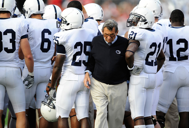 COLUMBUS, OH - NOVEMBER 13:  Head Coach Joe Paterno of the Penn State Nittany Lions pushes his way through a group of his players during a timeout in a game against the Ohio State Buckeyes at Ohio Stadium on November 13, 2010 in Columbus, Ohio.  (Photo by