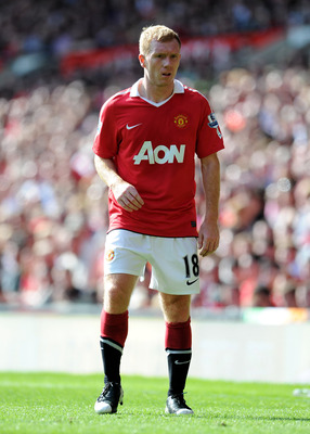 MANCHESTER, ENGLAND - APRIL 09: Paul Scholes of Manchester United looks on during the Barclays Premier League match between Manchester United and Fulham at Old Trafford on April 9, 2011 in Manchester, England.  (Photo by Michael Regan/Getty Images)