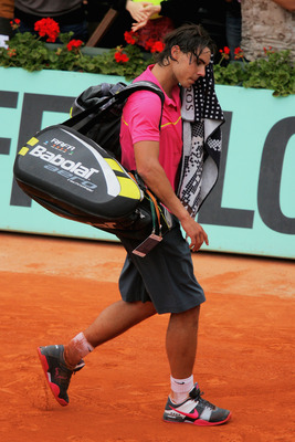PARIS - MAY 31:  Defeated champion Rafael Nadal of Spain walks off court following his defeat during the Men's Singles Fourth Round match against Robin Soderling of Sweden on day eight of the French Open at Roland Garros on May 31, 2009 in Paris, France.