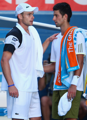 MELBOURNE, AUSTRALIA - JANUARY 27:  Novak Djokovic of Serbia congratulates Andy Roddick of the United States of America after Djokovic retired from his quarterfinal match during day nine of the 2009 Australian Open at Melbourne Park on January 27, 2009 in