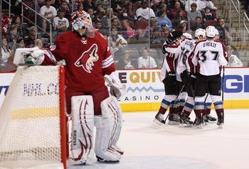 GLENDALE, AZ - APRIL 01:  The Colorado Avalanche celebrate after Philippe Dupuis #11 scored a first period goal past goaltender Ilya Bryzgalov #30 of the Phoenix Coyotes during the NHL game at Jobing.com Arena on April 1, 2011 in Glendale, Arizona.  (Phot