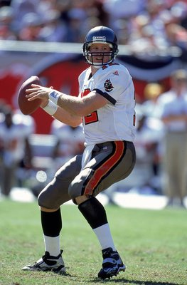 24 Oct 1999: Trent Dilfer #12 of the Tampa Bay Buccaneers moves back to pass the ball during the game against the Chicago Bears at the Raymond James Stadium in Tampa, Florida. The Buccaneers defeated the Bears 6-3.