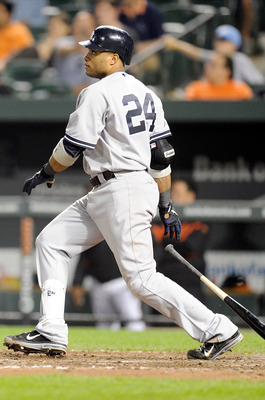 BALTIMORE, MD - MAY 18:  Robinson Cano #24 of the New York Yankees doubles in the winning runs in the fifteenth inning against the Baltimore Orioles at Oriole Park at Camden Yards on May 18, 2011 in Baltimore, Maryland. New York won the game 4-1.  (Photo