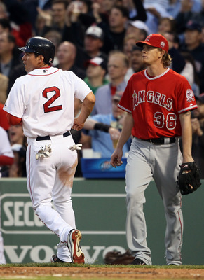 BOSTON, MA - MAY 02:  Jacoby Ellsbury #2 of the Boston Red Sox scores a run as Jered Weaver #36 of the Los Angeles Angels stands behind home plate on May 2, 2011 at Fenway Park in Boston, Massachusetts.  (Photo by Elsa/Getty Images)