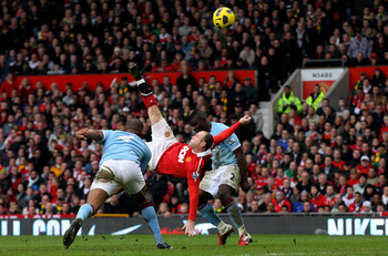 MANCHESTER, ENGLAND - FEBRUARY 12:  Wayne Rooney of Manchester United scores a goal from an overhead kick during the Barclays Premier League match between Manchester United and Manchester City at Old Trafford on February 12, 2011 in Manchester, England.
