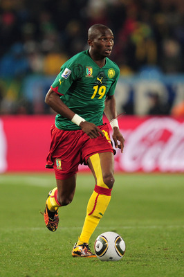 PRETORIA, SOUTH AFRICA - JUNE 19:  Stephane Mbia of Cameroon runs with the ball during the 2010 FIFA World Cup South Africa Group E match between Cameroon and Denmark at Loftus Versfeld Stadium on June 19, 2010 in Tshwane/Pretoria, South Africa.  (Photo b