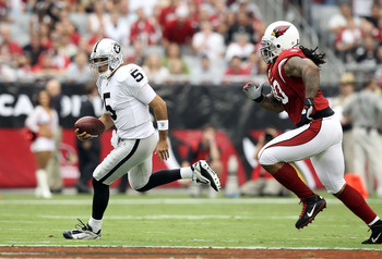 GLENDALE, AZ - SEPTEMBER 26:  Quarterback Bruce Gradkowski #5 of the Oakland Raiders scrambles with the football during the NFL game against the Arizona Cardinals at the University of Phoenix Stadium on September 26, 2010 in Glendale, Arizona.  The Cardin