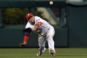 PHILADELPHIA, PA - APRIL 15: Shane Victorino #8 of the Philadelphia Phillies catches a fly ball during the game against the Florida Marlins at Citizens Bank Park on April 15, 2011 in Philadelphia, Pennsylvania. The Marlins won 4-3. (Photo by Drew Hallowel