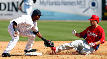 TAMPA, FL - FEBRUARY 26:  Shortstop Eduardo Nunez #67 of the New York Yankees takes the throw at second as designated hitter Ross Gload #7 of the Philadelphia Phillies slides in safely during a Grapefruit League Spring Training Game at George M. Steinbren