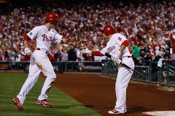 PHILADELPHIA - OCTOBER 23:  Chase Utley #26 of the Philadelphia Phillies is congratulated by Shane Victorino #8 after scoring on a first inning sacrifice fly by Jayson Werth against the San Francisco Giants in Game Six of the NLCS during the 2010 MLB Play