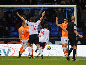 BOLTON, UNITED KINGDOM - NOVEMBER 27: Mark Davies (16) of Bolton celebrates after scoring the second goal for his side during the Barclays Premier League match between Bolton Wanderers and Blackpool at the Reebok Stadium on November 27, 2010 in Bolton, En