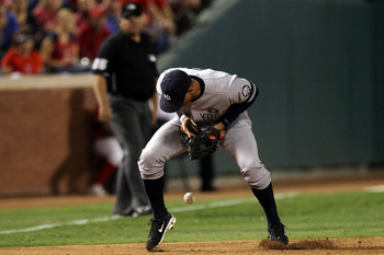 ARLINGTON, TX - OCTOBER 15:  Alex Rodriguez #13 of the New York Yankees commits an error in the sixth inning against the Texas Rangers in Game One of the ALCS during the 2010 MLB Playoffs at Rangers Ballpark in Arlington on October 15, 2010 in Arlington,