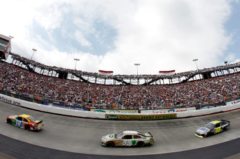 BRISTOL, TN - MARCH 20:  Kyle Busch, driver of the #18 M&M's Toyota, leads Carl Edwards, driver of the #99 Scotts EZ Seed Ford, and Jimmie Johnson, driver of the #48 Lowe's/Kobalt Tools Chevrolet, during the NASCAR Sprint Cup Series Jeff Byrd 500 Presente