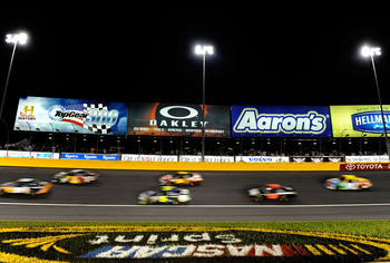 CHARLOTTE, NC - MAY 21:  A view of cars racing during the NASCAR Sprint All-Star Race at Charlotte Motor Speedway on May 21, 2011 in Charlotte, North Carolina.  (Photo by John Harrelson/Getty Images for NASCAR)