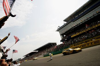 LE MANS, FRANCE - JUNE 18:  The Corvette Racing Team celebrate winning LM GT1 class during during the Le Mans 24h race on June 18, 2006 at the Circuit des '24 Heures du Mans' in Le Mans, France.  (Photo by Getty Images)