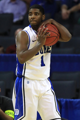 CHARLOTTE, NC - MARCH 18:  Kyrie Irving #1 of the Duke Blue Devils holds the ball in the second half while taking on the Hampton Pirates during the second round of the 2011 NCAA men's basketball tournament at Time Warner Cable Arena on March 18, 2011 in C