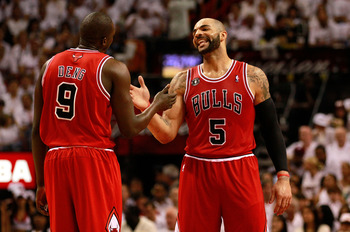 MIAMI, FL - MAY 24:  Carlos Boozer #5 (R) and Luol Deng #9 of the Chicago Bulls celebrate a play against the Miami Heat in Game Four of the Eastern Conference Finals during the 2011 NBA Playoffs on May 24, 2011 at American Airlines Arena in Miami, Florida