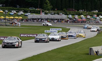 ELKHART LAKE, WI - JUNE 19: Cars lead by Jason Leffler, drining the #38 Great Clips Toyota, race during the NASCAR Nationwide Series Bucyrus 200 at Road America on June 19, 2010 in Elkhart Lake, Wisconsin. (Photo by Jonathan Daniel/Getty Images)