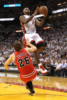 MIAMI, FL - MAY 22:  LeBron James #6 of the Miami Heat drives for a shot attempt against Kyle Korver #26 of the Chicago Bulls in Game Three of the Eastern Conference Finals during the 2011 NBA Playoffs on May 22, 2011 at American Airlines Arena in Miami,